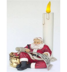 SANTA CLAUS SITTING WITH CANDLE