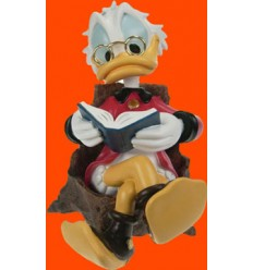 UNCLE SCROOGE READING A BOOK