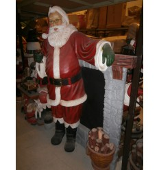 SANTA STANDING BESIDE A CHIMNEY